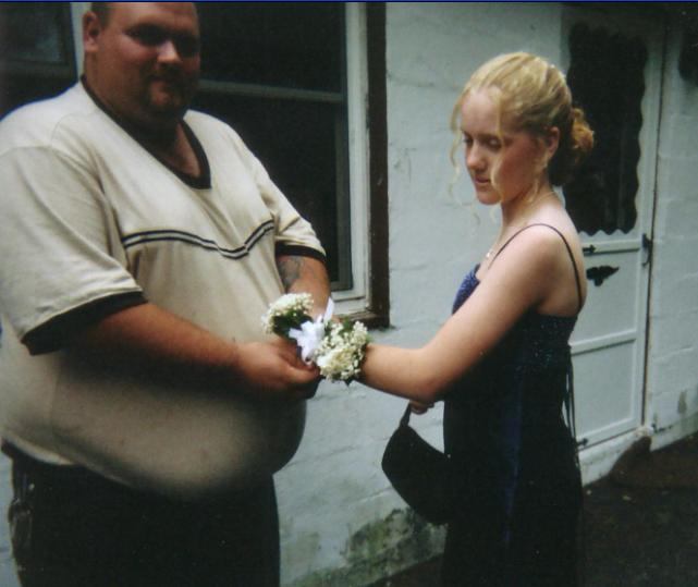 Jake helps Carly with her corsage.